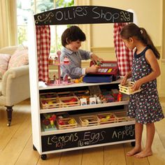 Great idea:) Lets play shop. Inexpensive chalkboard pain will spruce up a set of kiddy sized shelves. Add baskets and plastic fruit!