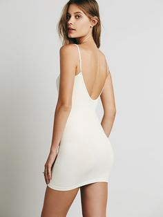 Seamless Low Back Mini Slip | Seamless mini slip with a low plunge back. Adjustable straps.