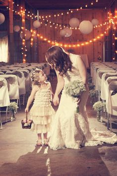 Such a cute moment between the bride and the flower girl! Photo by Sarah M. #MinneapolisWeddingPhotographer #KidsInWeddings #FlowerGirl #Bride #Love #Cute