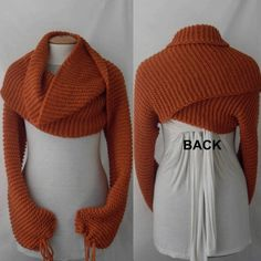 Find pattern and make for Valerie  Scarf shawl with sleeves at both ends in dark orange. by vinevirak