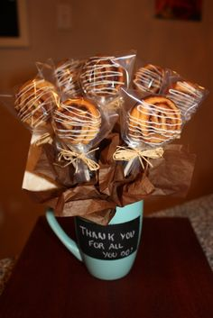 Cinnamon Bun Bouquet (made from canned dough) can be placed into a Coffee Mug sprayed with chalkboard paint. Just tape off a section, spray paint, & write a personnel message. Tuck in a gift card if needed! DLW