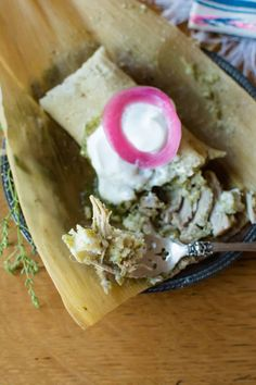 Pork Tamales with Salsa Verde- authentic Mexican Tamales filled with tender pork shoulder and tangy tomatillo salsa, perfect for your holiday feast! These are time consuming, but can be made in stages, or even better—with friends! #porktamales #porkchiliverdetamales #greenporktamales #tamalesrecipe