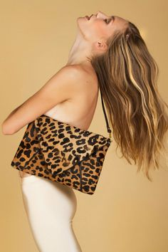 Jill leather and calf hair oversized clutch with detachable leather strap for conversion into a shoulder bag, $383.