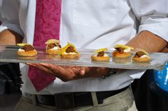 Onion, pepper, and meat atop delectable biscuit bites by 24 carrots Catering & Events