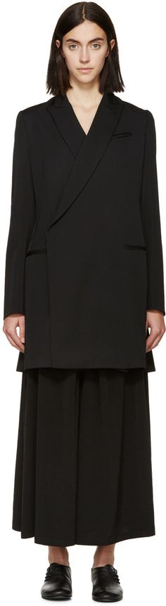 Long sleeve wool gabardine blazer in black. Peaked lapel collar. Single-button closure at front. Breast pocket. Welt pockets at waist. Vented at back hem. Fully lined. Tonal stitching.