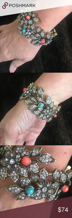 HEIDI DAUS SPRING LOADED BRACELET SIZE 7-8. HEIDI DAUS spring-loaded bracelet. SIZE 7-8. Swarovski crystals in a flower MOTIF around ENTIRE bracelet. Turquoise and orange embellishments on flowers. Weighted. HEIDI DAUS Jewelry Rings