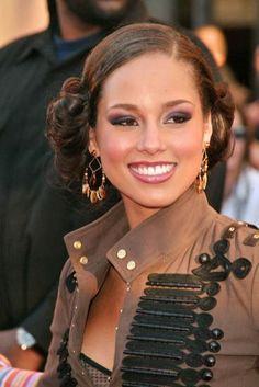 """Alicia Keys...I should have put up a pic of her with the cornrows b/c when they were the """"in"""" thing and I wore them frequently I was told repeatedly that I look like Ms. keys...I think she is beautiful so I will take it!!! (but I don't really agree)"""