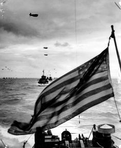 In this photo: Columns of Coast Guard LCI's, protected by barrage balloons against low flying Nazi strafers, advance upon the beaches of France. A Coast Guard combat photographer, going into the invasion on an LCI, caught this picture of the advance guard of the Liberation Fleet in the English Channel.