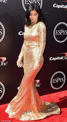 Queen of the cover up: Kendall's long sleeved high necked dress looked beautiful and flatt...