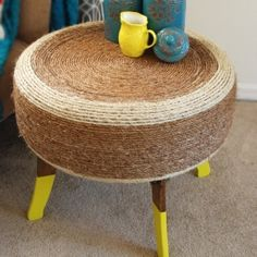 How to make a table out of an old tire. I like this but I don't know about the twine/whateverthatis material.
