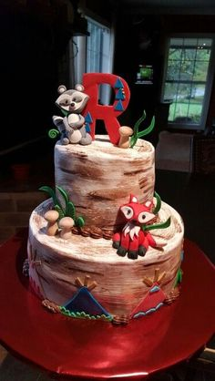 Wilderness baby shower cake.  Fox, raccoon, teepees, and mushrooms.   Someone else originally came up with this design. I just used it as a guideline. I don't know who it was.