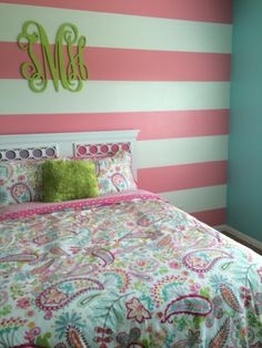 Tatums bedroom!! Almost finished :) turquoise wall as with pink striped accent wall. Lime green monogram with pottery barn teen bedding paisley.