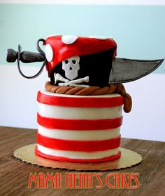 Pirate Cake - Pirates and more pirates. Striped red and white cake. Edible sword, loved it