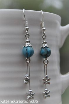 Turquoise marble dangle earrings. Perfect for Mothers day. Turquoise, a blend of the color blue and the color green, has some of the same cool and calming attributes. The color turquoise is associated with meanings of refreshing, feminine, calming, sophisticated, energy, wisdom,