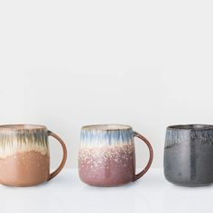 THE PRODUCT Enjoy a mug of your favourite hot drink in one of these glazed mugs, finished in an multicolour glaze. This classic style has been given a contemporary glaze finish which is unique for each cup. These ceramic mugs will will add an elegant addition to any kitchen. Due to handmade nature of this product varia