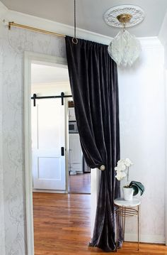 Wallpapered Hallway | Drapery over Door | Vintage Lucite Chandelier