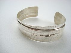 Fold formed sterling silver hammer textured into a cuff shape I wanted the fold to be off center so one end is wider than the other giving it an unusual Sterling Silver Cuff Bracelet, Hammered Silver, Cuff Bracelets, Texture, Handmade, Jewelry, Surface Finish, Hand Made, Jewlery