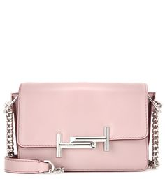 Tod's - Double T Mini leather shoulder bag - Tod's shows off a fresh take on the compact shoulder bag with this leather Double T Mini design. The compact size is perfect for toting all of your daytime essentials, while the mauve-pink leather and silver-tone hardware adds an elegant edge. Carry yours over your shoulder or in the crook of your arm for a refined look. seen @ www.mytheresa.com