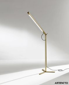 Level A01 is a freestanding light designed by Artefatto design Studio for Laura Meroni. The free standing brass cylinder can be inclined from its hinged break point up to 90 degrees and can rotate full circle depending on its use. This makes the light a great companion because it is usable as a sofa light, a desk light, bed side light as well as sculptural object standing next to the window.