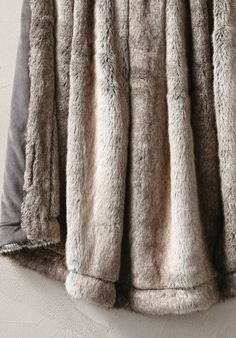 Our Luxury Faux Fur Throw is densely woven of highly prized Japanese fibers with a silken touch. Each has incredibly natural colorations and deep, soft pile that replicates the look and feel of real fur.