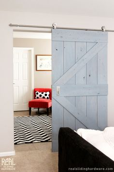I would love love love a barn door to be used somehow in the studio. Also love this light blue wash on the door. ES
