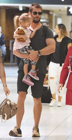 Doting father: Australian actor Chris Hemsworth (pictured) was spotted leaving Sydney airp...