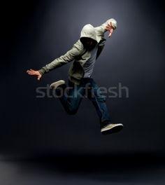 Modern Dance Hip Hop Dancer Posing On Dark Background Stock Photo by Yuri_Arcurs Jazz Dance Photography, Sport Photography, Urban Hip Hop, Web Design, Dance Instructor, Learn To Dance, Dance Poses, Street Dance, Hip Hop Dance