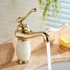 Free Shipping Luxury Brass Bathroom Faucet Cabinet Sink Basin Mixer Tap Cold Hot Water taps Gold Golden With Hardstone 22C1372. Yesterday's price: US $159.90 (132.32 EUR). Today's price: US $71.96 (59.50 EUR). Discount: 55%.