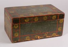 Painted and Stencil Decorated Pine Box, Mahantango Valley in central Pennsylvania , early 19th century, rectangular box with wire hinged lid, painted blue with red striping decorated with borders of alternating red spotted diamonds and yellow blossoms, with green leaf sprigs in the corners, (paint wear), ht. 9 1/4, wd. 19 1/4, dp. 11 in.