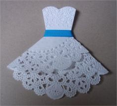 Paper Doily Dress - I inserted these with bridal shower invitations. (And I even simplified my method compared to the provided instructions)