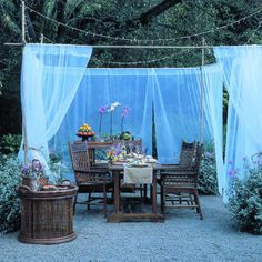 DIY Portable Dining Retreat - The use of potted plants, PVC pipe, and mosquito netting make it a snap to assemble. Just add candles or string lights to make the space shine at night.