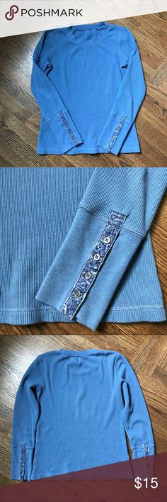 """Super Quality Sky Blue Thermal with  Velvet Trim M This is from Sundance- see tag in last photo, which I removed when I bought because tags bother me. It is the high quality thermal, a nice soft, thick cotton weave. Perfect for Spring. It has the velvet trim in the sleeves, which convinced me to buy it- so subtle and pretty. Alas, this is a little big on me so am reposhing. Very comfortable and flattering. B 18"""" (unstretched)  L 23"""" Thanks for shopping my closet!🙏🏼 Sundance Tops Tees…"""