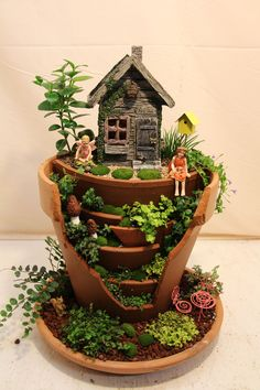 Multi-layer broken pot fairy garden! Best thing about breaking a pot for a fairy garden is that you cant mess up, just play with the pieces that break off!