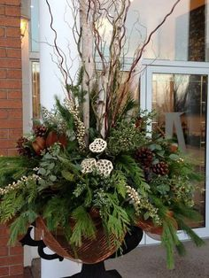 43 Marvelous Outdoor Holiday Planter Ideas To Beauty Porch Décor Outdoor Christmas Planters, Christmas Urns, Christmas Greenery, Outdoor Christmas Decorations, Christmas Holidays, Christmas Wreaths, Winter Holiday, Winter Porch, Winter Planter