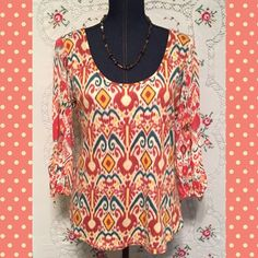 "LUCKY BRAND Top! Sweet LUCKY BRAND top with 3/4 length sleeves with tie detail. Aztec print in coral and teal. Length is 24.75"" and measures 21"" across chest. Cotton and modal blend. Lucky Brand Tops"