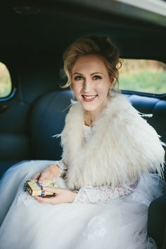 An Original Tiered 1950s Wedding Dress For A Quirky and Theatrical Style Winter Wedding.  Bride wears an ostrich feather cover-up.  On #LoveMyDress.  http://helenlisk.blogspot.co.uk/