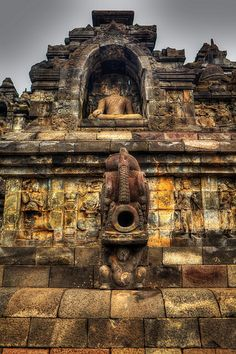 Borobudur - Java - Indonesia.The object with around hole in the middle is not a canon, but an ancient gargoyle, as a part of a draining system to avoid the complex being flooded/drowned in rain water.