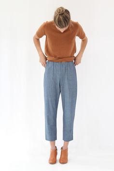 100% organic cotton chambray, elastic waist, crazy comfortable. Slightly cropped. To be wore just below true waist but work a little higher or a little lower. Loose drape fit. Model is wearing a small