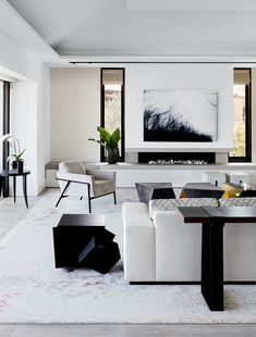 """[Thomas Hamel & Associates](""""_blank"""") and [Behurz Studio](""""_blank"""") collaborated on the living room's area rug. Artwork by Chris Langlois from [Olsen Irwin](""""_blank""""). Bohemian Interior Design, Modern Interior Design, Living Room Area Rugs, Living Room Decor, Design Salon, Building A New Home, Fireplace Design, Living Room Inspiration, Luxury Living"""