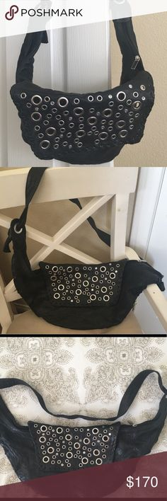 Treesje Black Leather Hobo Bag. Wow-Cute! Treesje Washed Black Leather Hobo with Grommets and Rhinestones. Seriously my most favorite bag ever! Cute, soft, holds a ton, stylish and you will get a lot of compliments when you wear it.  Cute leather pocket inside too. Treesje Bags Hobos