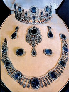 Sapphire and diamond parure, once owned by Queen Hortense. In 1821 King Louis Philippe acquired a tiara, a necklace, a pair of earrings and a brooch for his spouse Marie-Amélie; the parure was handed down until they were sold to the Louvre Museum. Royal Crown Jewels, Royal Crowns, Royal Tiaras, Royal Jewelry, Tiaras And Crowns, Jewelry Sets, Fine Jewelry, Antique Jewelry, Vintage Jewelry