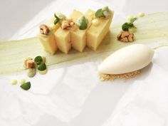 Lemon cake, lemon curd, basil yogurt, microbasil, honey-roasted nuts, and greek yogurt sorbet.