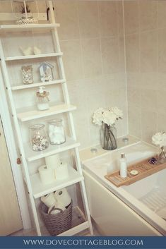 Vintage style bathroom in neutral colours with hints of nautical-themed accessories. Ladder shelving makes the most of a small space.