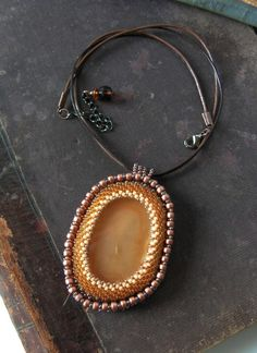 SALE Bead embroidery Agate pendant Necklace Beadwork pendant Bead embroidered jewelry Brown Beige Copper 30% off. $33.00, via Etsy.