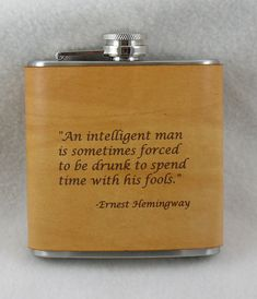 """""""An intelligent man is sometimes forced to be drunk to spend time with his fools"""". - Ernest Hemingway"""