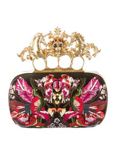 Black and multicolor satin Alexander McQueen Knuckle Box clutch with embroidered print throughout, gold-tone frame and hardware, black leather lining and top brass knuckle clasp closure featuring unicorn and skull embellishments. Includes dust bag and tags. Shop authentic handbags by Alexander McQueen at The RealReal.