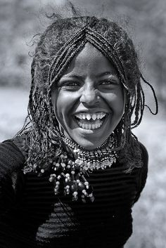 Afar girl laughing, Danakil, Ethiopia