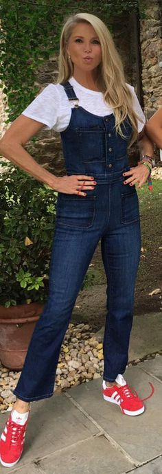 Who made Christie Brinkley's red sneakers and denim overalls?