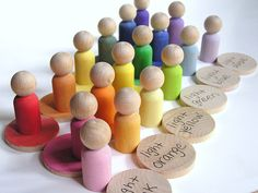 Your RAINBOW WHEEL comes with 18 extra large 2 inch discs in every shade of the rainbow- red, orange, yellow, green, blue and purple. From lightest to darkest.Your set also comes with 18 wooden people, to match all of the rainbow discs.    Etsy Shop Owner: applenamos