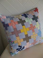 I have started a new project inspired by the pictured pillow (left)  by Zum-Zum on Flickr.    There are countless variations of cross quilts but this particular layout really appealed.